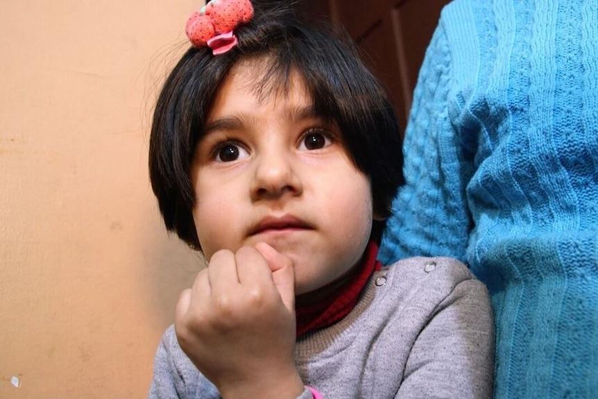 four year old Naya stares at the camera