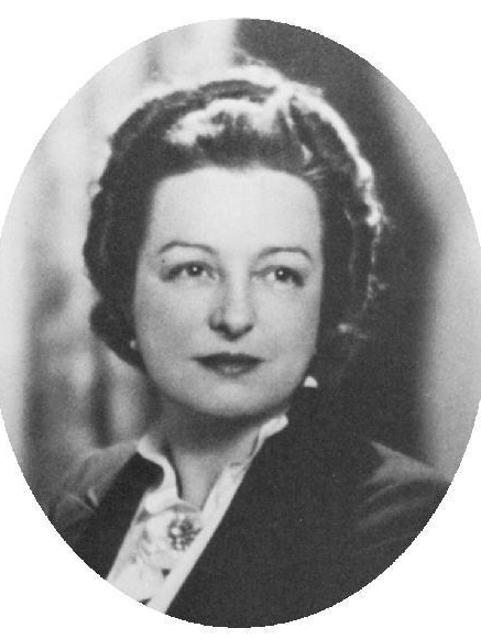 A black and white portrait of a striking middle-aged woman