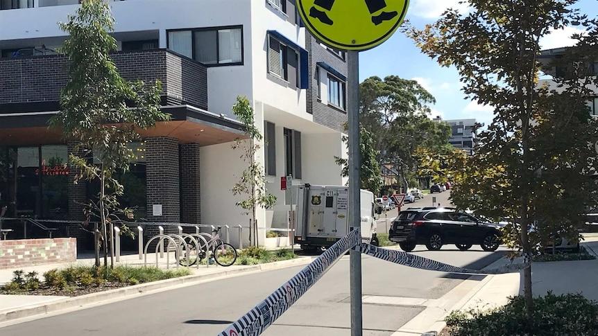 An armaguard van on a suburban street behind police tape
