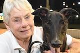 Karen Leek, a smiling middle-aged woman next to a greyhound.