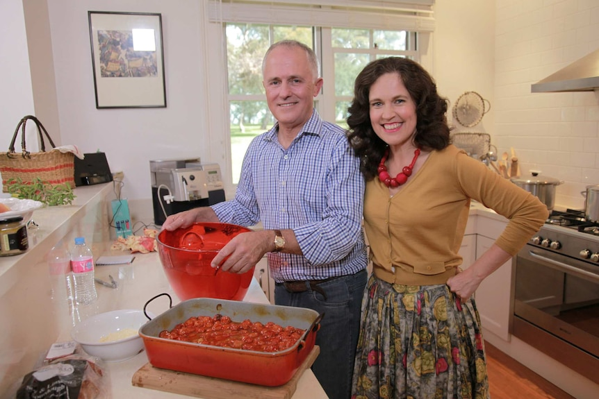 Turnbull and Crabb in kitchen.