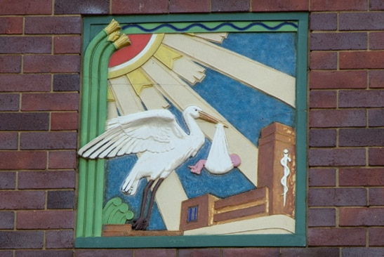 A stork motif above the entrance to the King Edward Memorial Hospital for Women.