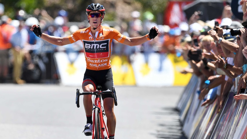 Richie Porte celebrates on Willunga Hill as he crosses the line to win stage five of the Tour Down Under