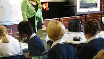 Students and teacher in a classroom (ABC News: Jonathan Beal)