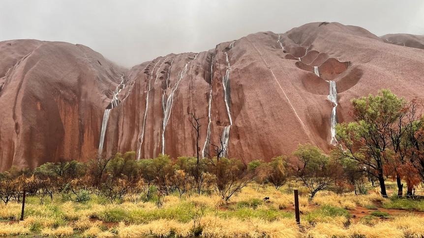 Waterfalls cascade down Uluru as severe weather brings heavy rain to NT – ABC News
