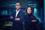 Allan Clarke and Suzie Smith with arms crossed looking to camera in office with blue light in background.
