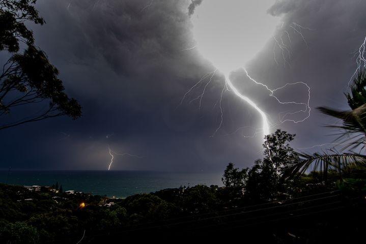 A lightning bolt strikes close to the camera.