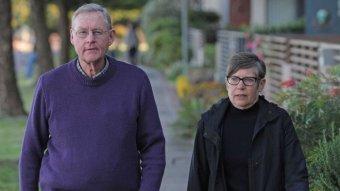 Simon and Helen Palfreeman walk down a footpath.
