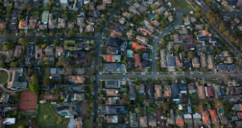 An overhead view of houses and streets