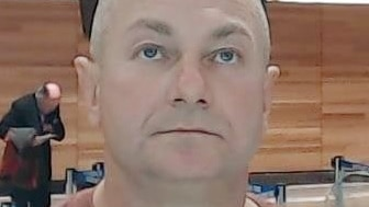 A man looks at the camera.