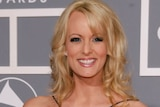 Stormy Daniels, whose real name is Stephanie Clifford, wearing a black dress at award night