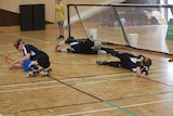 Goalball players defending a play