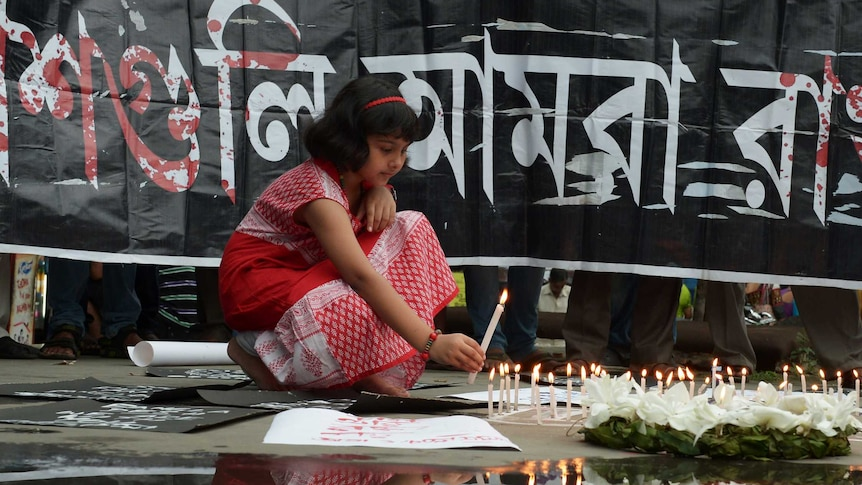 Indian social activists light candles during a protest in Kolkata