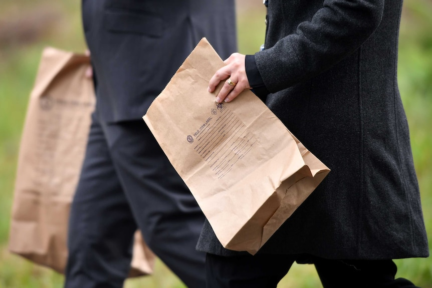 Police with evidence bag in William Tyrrell search