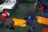 A rescue team prepares to evacuate Sumatra earthquake victims.