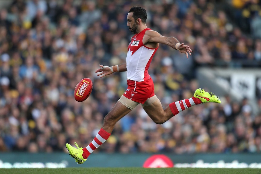 Colour photo of Adam Goodes of Swans kicking the ball during the round 17 AFL match against West Coast Eagles.