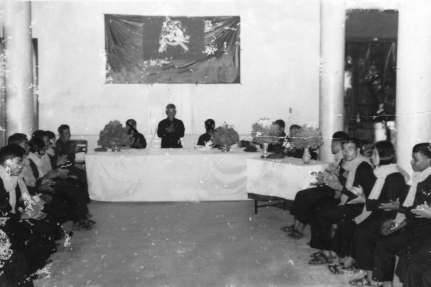 A black and white photo of a group wedding during the Khmer Rouge.