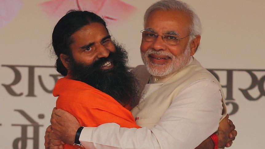 Billionaire godman Baba Ramdev hugs Indian PM Modi at a yoga festival in New Delhi in 2014.