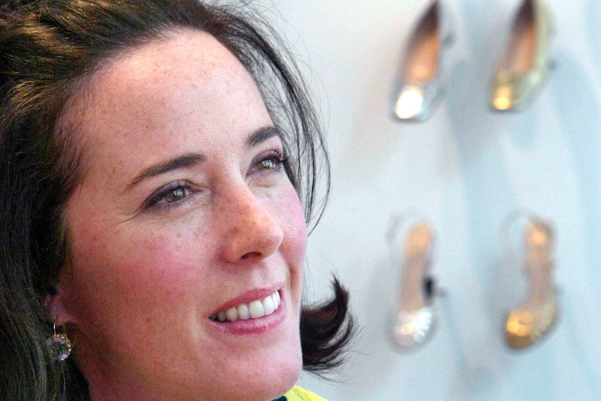 Close up of Kate Spade with her shoes in the background.