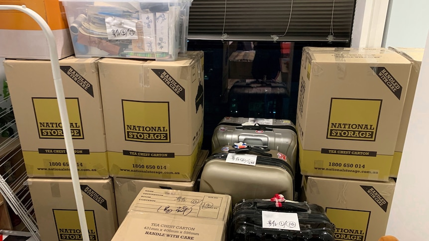 a plie of luggages and boxes.