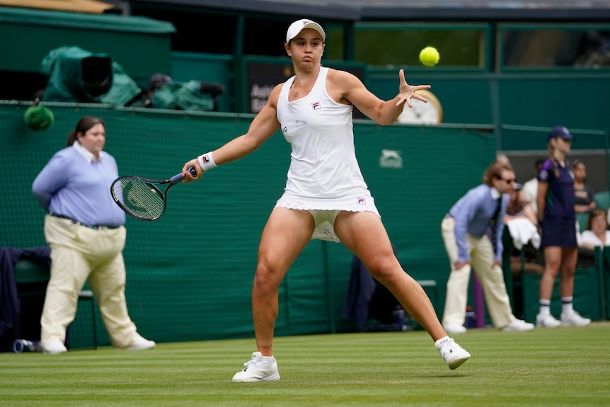 Ash barty winds up to play a forehand at Wimbledon.
