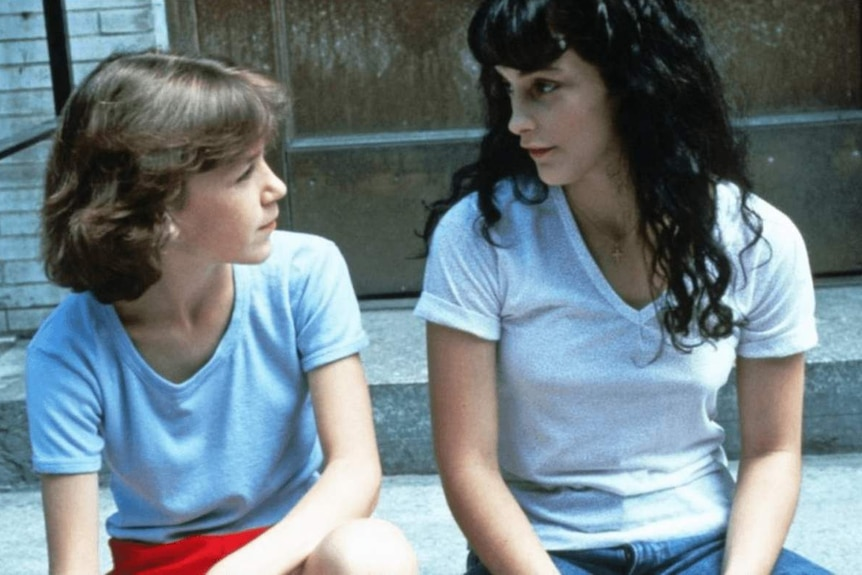 Still from the 1984 film Old Enough with two girls sitting on a stoop