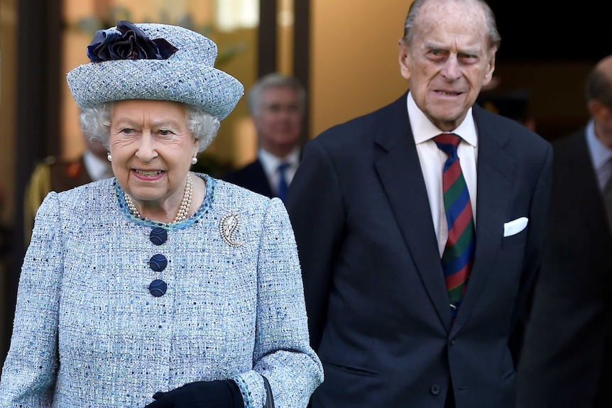 Queen Elizabeth II and Prince Philip, the Duke of Edinburgh leave the National Army Museum in London.