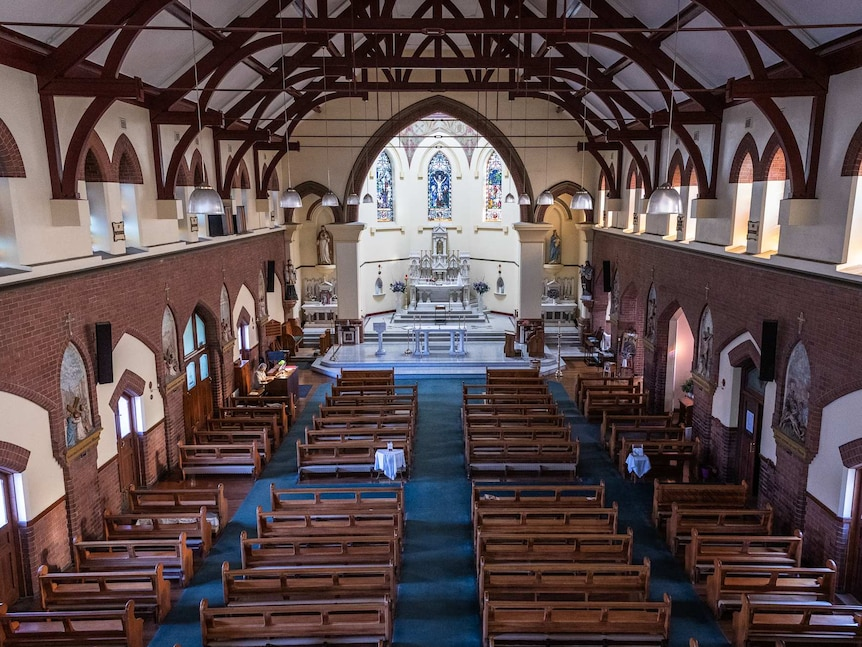 Empty rows of seats in the church