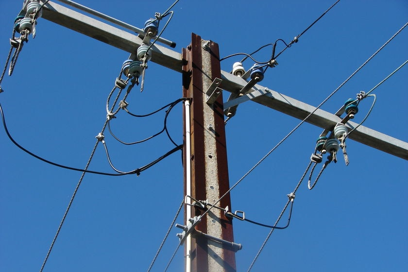 overhead wires on a power pole [stobie pole in Adelaide]