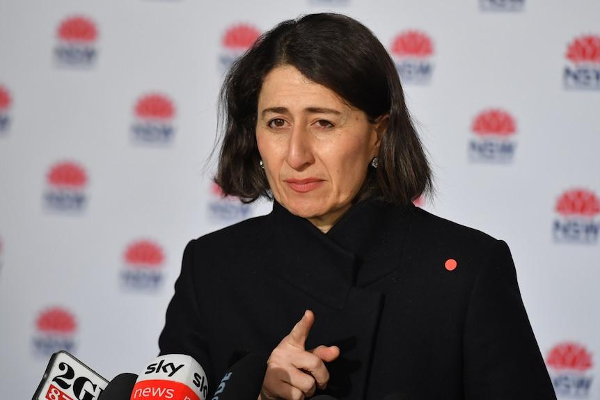 A woman wearing a black coat