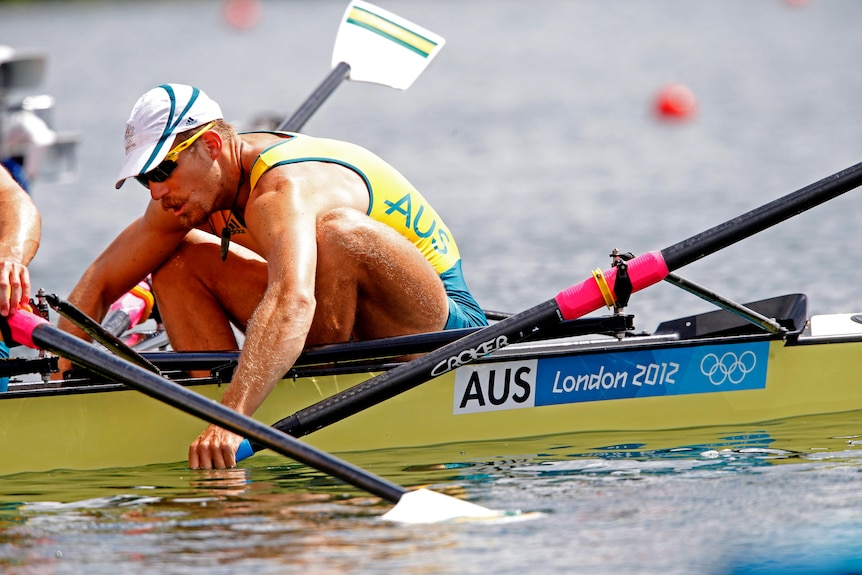 Chris Morgan slumps while in the rowing boat.