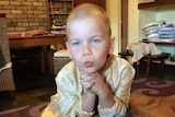 Perth child Oshin Kiszko pictured inside looking into the camera.