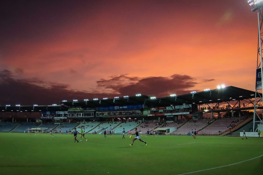 A match is seen being played at TIO Stadium during sunset.