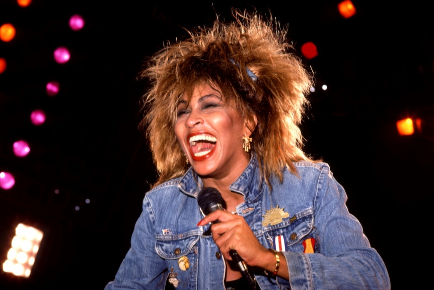 Tina Turner mic in hand performing in 1985