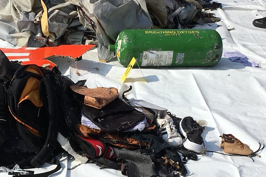 Personal items, including shoes, recovered from the crash site.