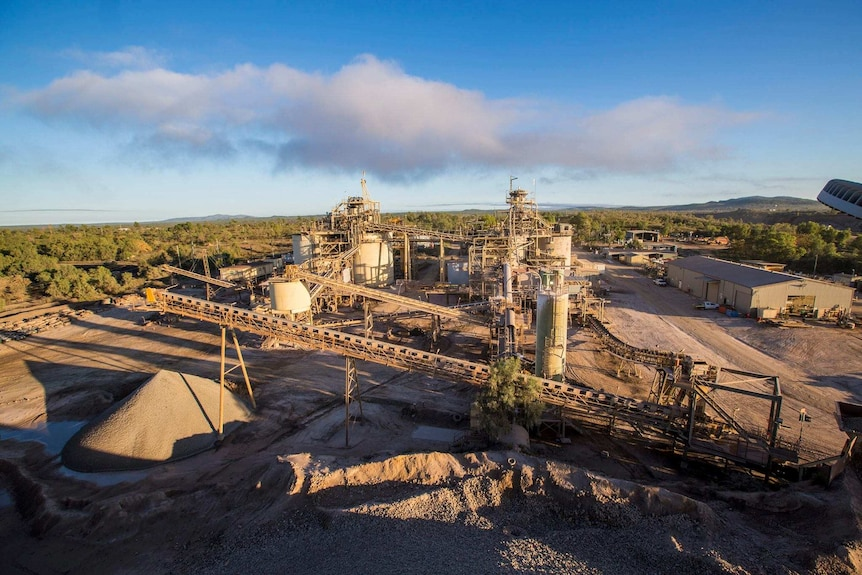 A gold mine with buildings and a conveyer belt