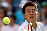 Kei Nishikori stretches for a backhand at the US Open