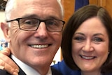 Sarah Henderson puts her arm around Malcolm Turnbull as they smile for a selfie