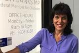Woman standing by office door
