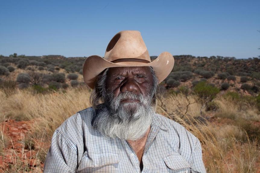 Artist Alec Baker in the remote community of Indulkana.