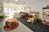 A room showing toys and play equipment for young children.