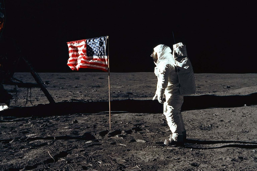 Buzz Aldrin with the US flag on the moon in 1969