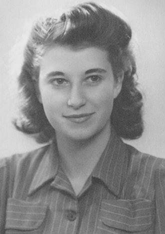 A woman smiles for a portrait