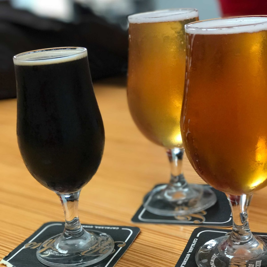 Three glasses of beer in a range of colours