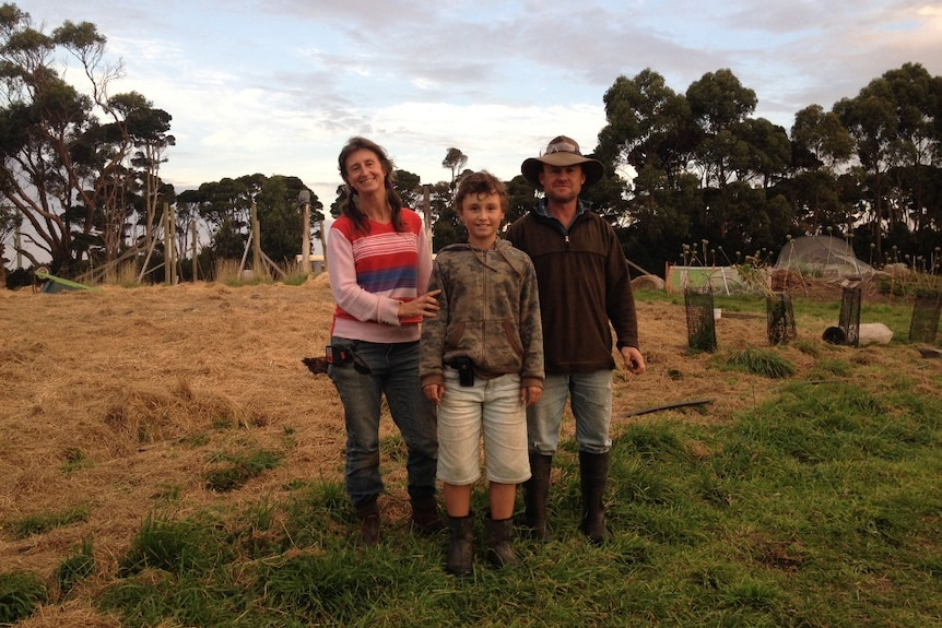 Carmen Holloway and James Hill, with their son Evan, on their new farm on King Island which is being opened to tourists
