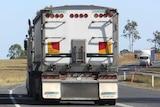 Trucks drive along the Bruce Highway.