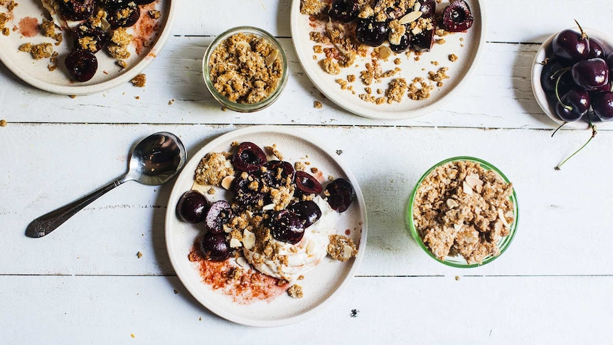 Individual dessert plates with whipped mascarpone, cherries and Anzac crumble for a festive and easy dessert recipe.