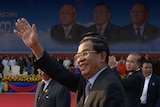 Cambodian prime minister Hun Sen greets supporters in Phnom Penh on January 7, 20