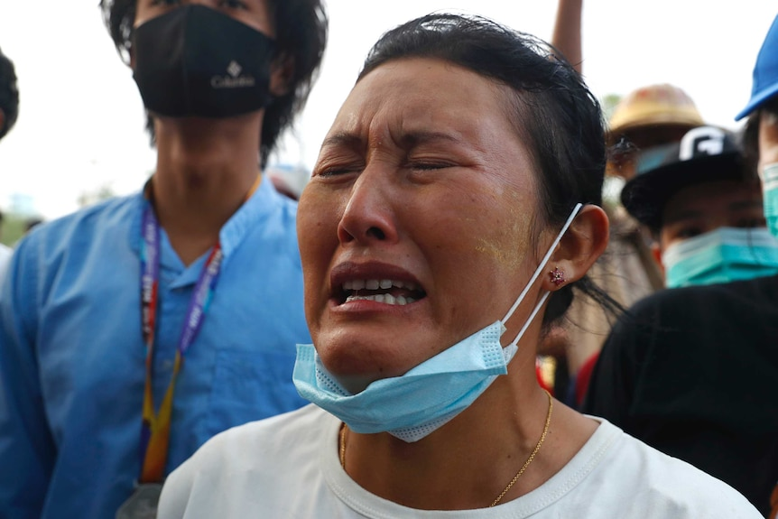 A woman cries during a memorial for killed protester Mya Thwet Thwet Khine