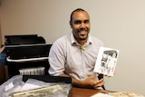 John Morseu with National Library items about the Torres Strait.